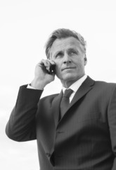 Mature businessman using cellphone