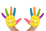 Fototapety two colorful hands with smile different colors of child as logo.
