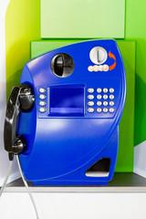 Blue public pay phone