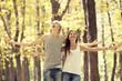 Teen couple at autumn park.