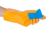 Gloved hand holding a kitchen sponge isolated on a white backgro