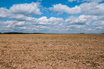 plowed field is empty in the sky