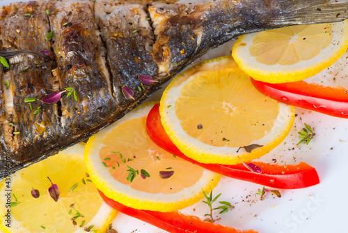 fish, sea bass grilled with lemon