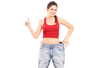 A weightloss girl giving a thumb up