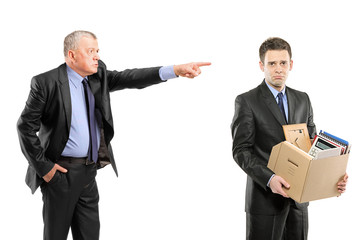 Angry boss firing a man carrying a box of personal items