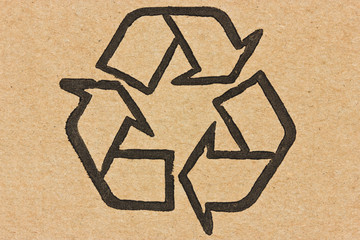 recycle symbol on a cardboard