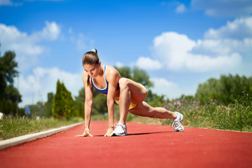 female runner stretching