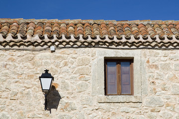 Stone facade, window and lamp