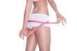 Slim girl measuring her hips