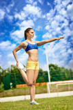 Athletic woman starching poster