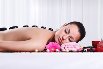 Relaxed woman in spa center