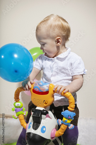 Cute baby riding a new toy