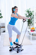 Woman exercising at home on stepper trainer