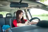 Beautiful girl driving car