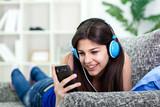 teenager girl listening to music