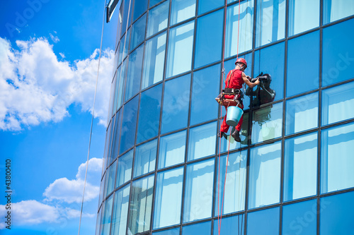 Window washer building windows from outside