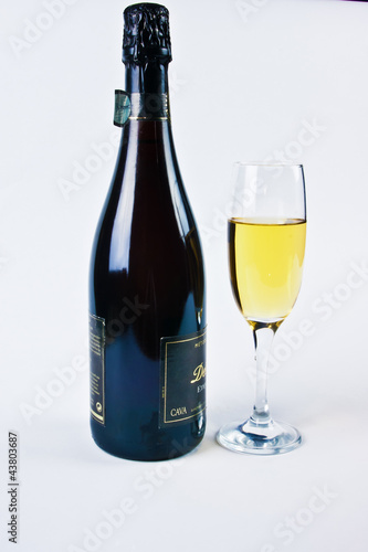 bottle with a glass of white wine