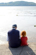 Girl With Her Granddad Together On A Pier