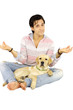 Young man with puppy labrador dog playing yoga position