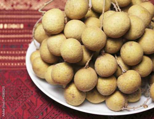 Longan fruit on white dish