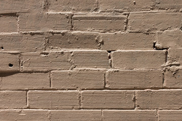 Yellow paint brick wall background