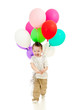 Jolly running child boy with bunch of colorful ballons in his ha
