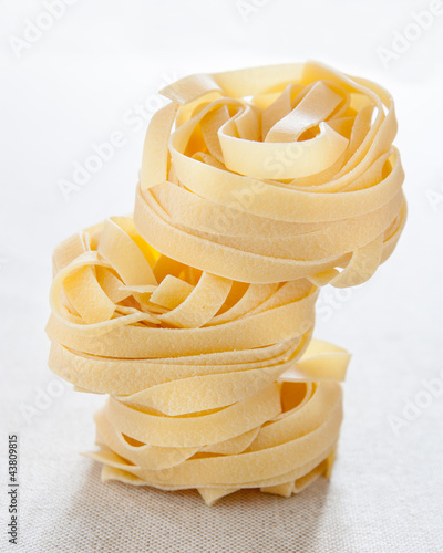 Pile of raw fettuccine nests