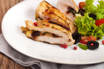 grilled chicken stuffed with mozzarella and sun-dried tomatoes