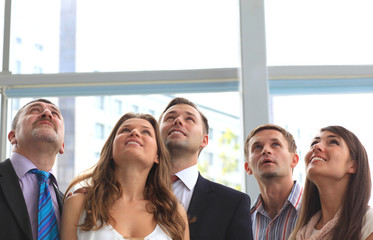 Group of executives looking up at something