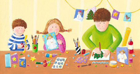 Happy family making Christmas postcards