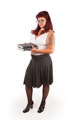 Pin-up librarian carrying books