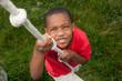 Boy climbing a rope