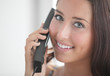 Woman on the phone smiling