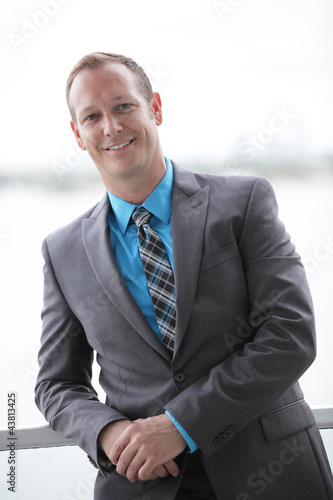 Businessman leaning on the ledge