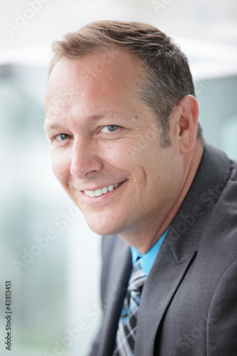 Stock image of a businessman smiling