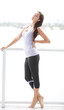 Healthy woman in fitness clothing