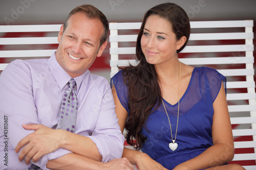 Couple sitting and smiling