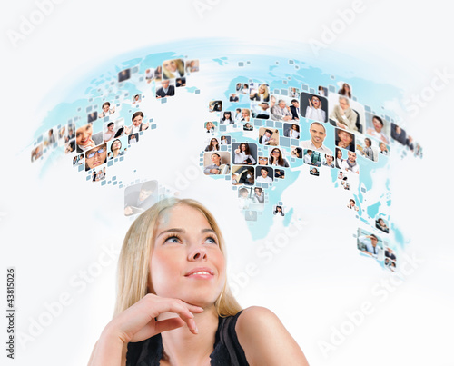 Young woman looking at virtual worldmap with photo of different