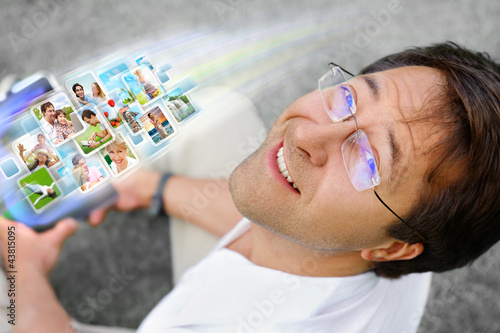 Man holding tablet computer and using social media. Always stay