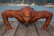 fit healthy strong man doing press ups outdoors.