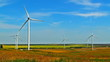 Rotating wind turbines on field