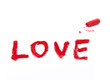 word LOVE and red pastel crayon