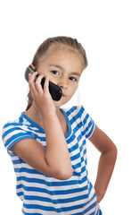 Little girl speaking by cell phone, white background