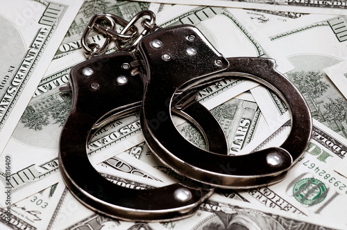 Dollars and handcuffs