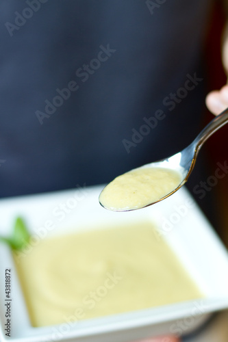 Up close Spoonful Yellow Summer Squash Soup