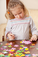 Girl playing puzzle