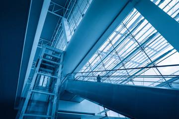 escalator in modern airport terminal