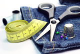 Denim jeans with dressmaking sewing utensils needlework concept poster