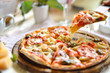 Original Italian seafood pizza sliced on wood dish