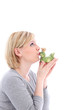 Hopeful woman kissing her frog